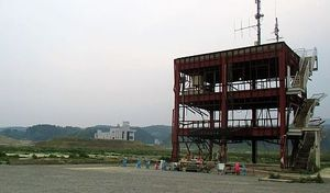 four_col_tsunami_tower_1_-_wide_shot_cropped__fixed